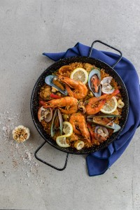 Paella Fiesta Filipina - Who says we have to cook paella like they do in spain? It's a dish that has become our own. Agos paella is cooked with a festive mix of seafood, chicken, chorizos and vegetables.