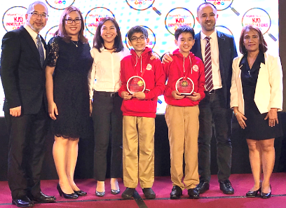 De La Salle Santiago Zobel's Zachary Santos and Dominic Ramos, Bronze Medalists in the 19th IRO's Creative Category Junior, accept their plaques of recognition as Wyeth Nutrition Kid Innovators Special Awardees with their parents by their side. They are joined by Philippine Robotics Team President Mr. Anthony Gabitan, Wyeth Philippines Inc. Communications Head Ms. Michelle Pador and DOST-SEI's S&T Manpower, Education, Research and Promotions Chief Dr. Ruby Cristobal.